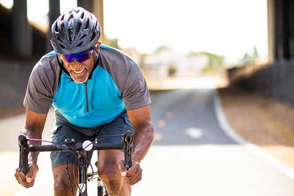 man-biking-bridge