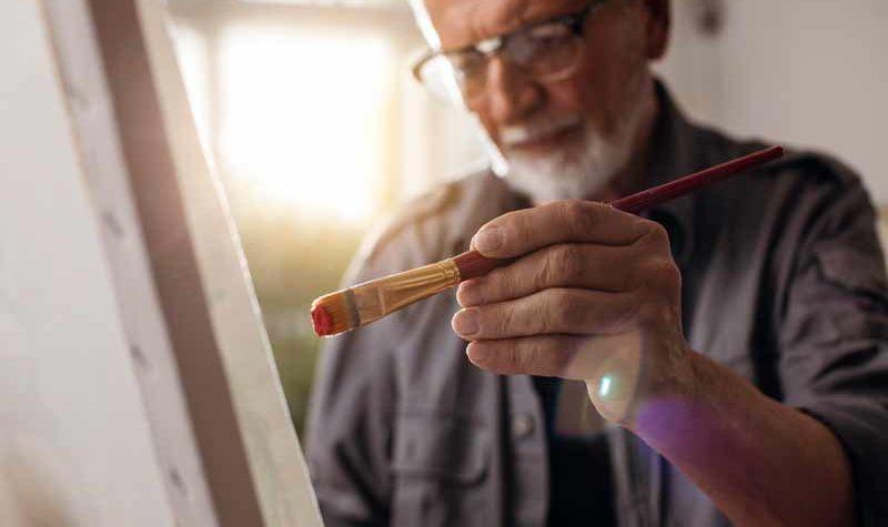 senior-living-man-painting-luxury-apartment-minneapolis-elmwood