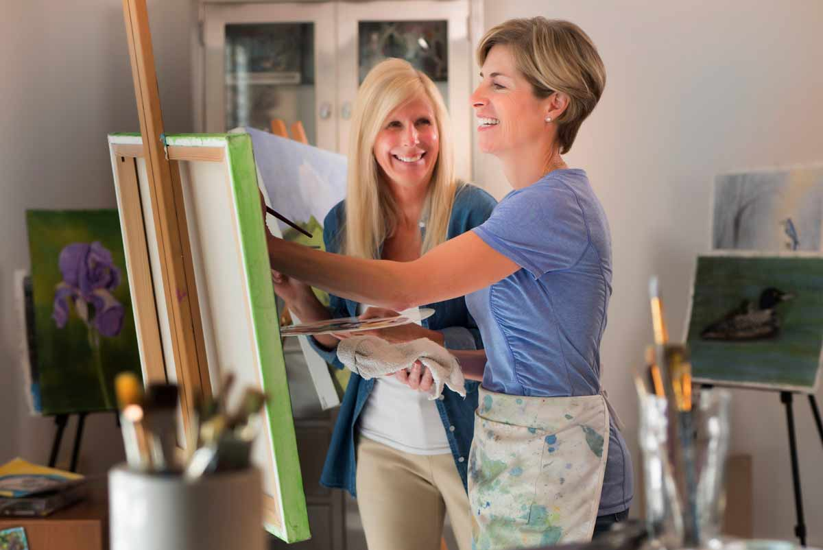 women-painting-hobby-luxury-community-apartment-minneapolis
