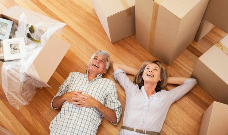 couple-downsize-moving-boxes